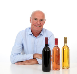 Portrait of winemaker with bottles of wine