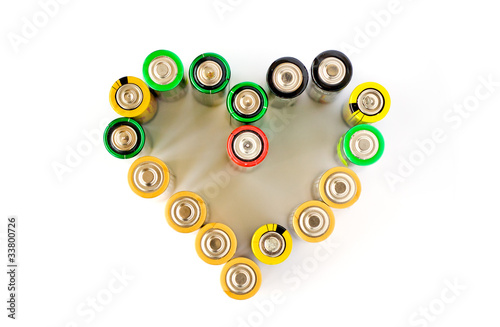 A heart made from AA batteries on the white background - 33800726