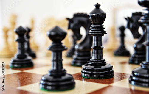 Chess pieces on wood board