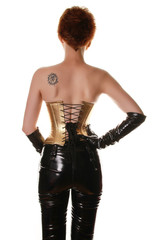 Fashion Girl in Golden Corset and Shiny Pants