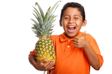 Child Smiling and Holding Pineapple with Thumb Up