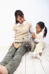 親子と犬のポートレート