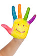 Colored hand with smile painted in colorful paints