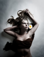 woman with white flower of chamomile