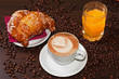 Brioches e cappuccino and juice