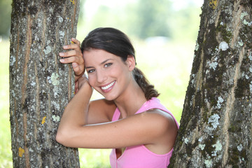 Young smiling woman posing in a park