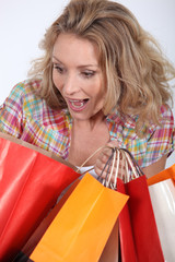 Woman looking surprised with shopping bags