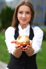 Businesswoman with moneybox