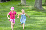 two girls running happy outdoor