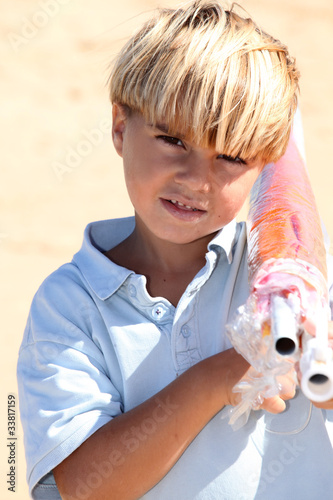 Boy carrying parasol