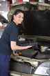 Happy Woman Mechanic with Diagnostic Tool