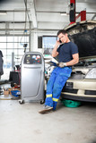 Mechanic Talking on Phone