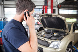 Mechanic talking on cell phone