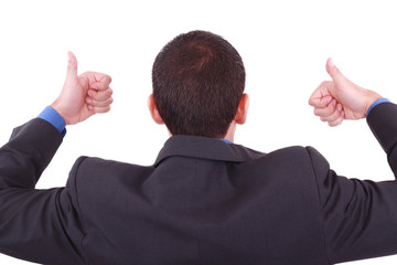 A businessman gives a thumbs up (back)