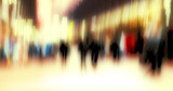 A motion and lens burred image of people moving poster