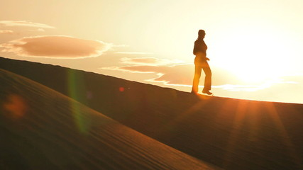 Hiker in Silhouette on Sand Dunes