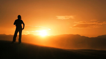 Female Hiker Watching the Sunset in the Desert