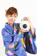 Young woman wearing Japanese kimono with mosquito coil