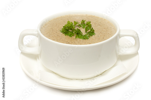 Soup with mushrooms isolated on white