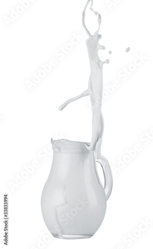 Cream splashing out of jug