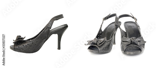 Pair of black elegant leather lady shoes