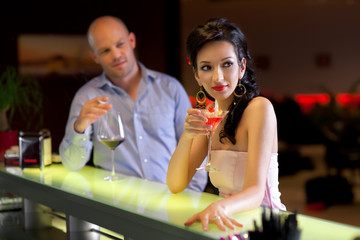 woman and man sitting by the bar