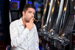 Leinwandbild Motiv casino player smoking cigar