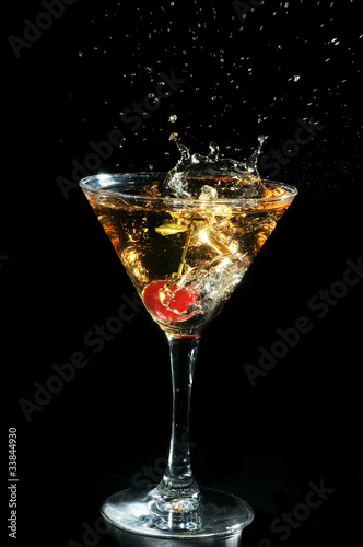 Cherry in a glass with champagne