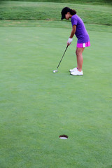 Girl Putting