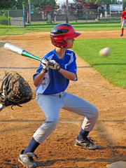 A hitter hitting a ball.