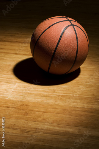 Basketball sitting on wood floor