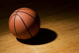 Basket ball sitting on wood floor