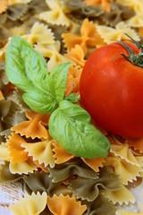 Italian pasta farfalle with basil and tomato