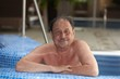 Portrait of mature man in swimming pool