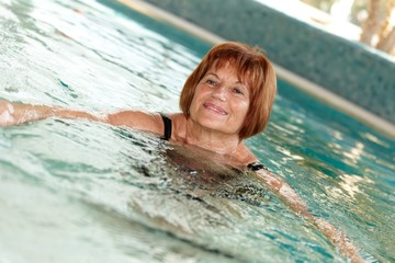 Mature lady at swimming pool