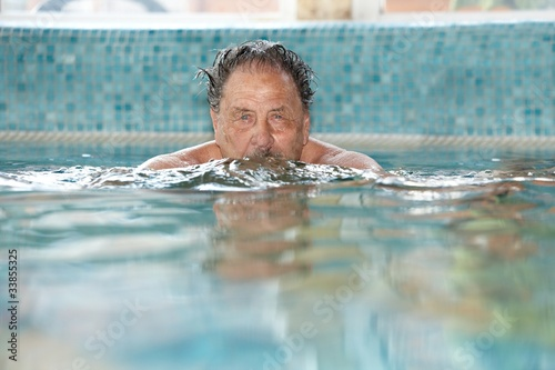 Elderly man at swimming pool