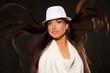 Beautiful brunette in white hat