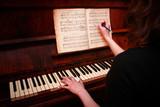 Girl playing on piano