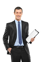 A smiling businessperson holding a blank clipboard