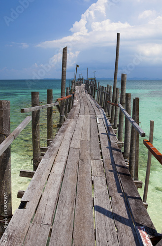 Obraz Wooden jetty in tropical waters.