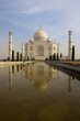Taj Mahal from southern entrance reflected in the pond