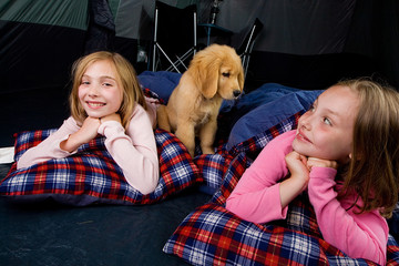 Kids Camping in a Tent with a puppy