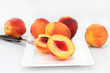 Farm fresh peaches cut and whole