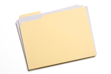Documents stuffed in Manila folder isolated on white