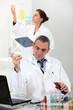 Scientists performing experiments
