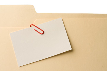 Blank message card clipped on file folder
