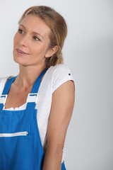 Woman in blue work dungarees