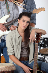 Young rock band with female guitarist