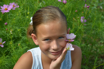 Young Girl in the Sun With Flowers