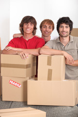Three lads with packing boxes